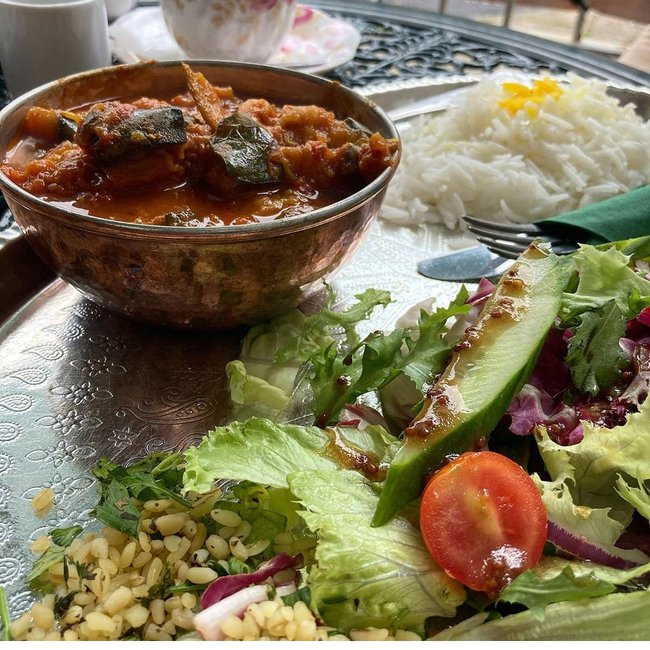 Yatimcheh: Aubergine and courgette in a garlic and tomato sauce, served with Persian rice topped with saffron and usual side salad and tabbouleh