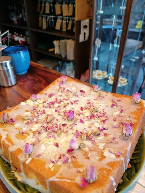 Persian Love cake: a fragrant rose cake flavored with freshly ground cardamom and almond flour, and topped with crushed pistachios and rose petals